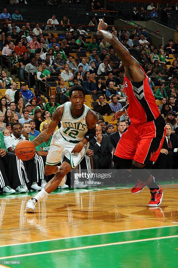 MarShon Brooks #12 of the Boston Celtics drives to the basket against the Toronto Raptors on October 7, 2013 at the TD Garden in Boston, Massachusetts.