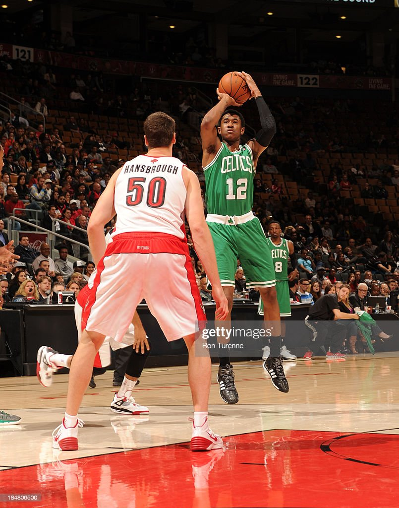 <a gi-track='captionPersonalityLinkClicked' href=/galleries/search?phrase=MarShon+Brooks&family=editorial&specificpeople=4884862 ng-click='$event.stopPropagation()'>MarShon Brooks</a> #12 of the Boston Celtics shoots against <a gi-track='captionPersonalityLinkClicked' href=/galleries/search?phrase=Tyler+Hansbrough&family=editorial&specificpeople=642794 ng-click='$event.stopPropagation()'>Tyler Hansbrough</a> #50 of the Toronto Raptors during the game on October 16, 2013 at the Air Canada Centre in Toronto, Ontario, Canada.
