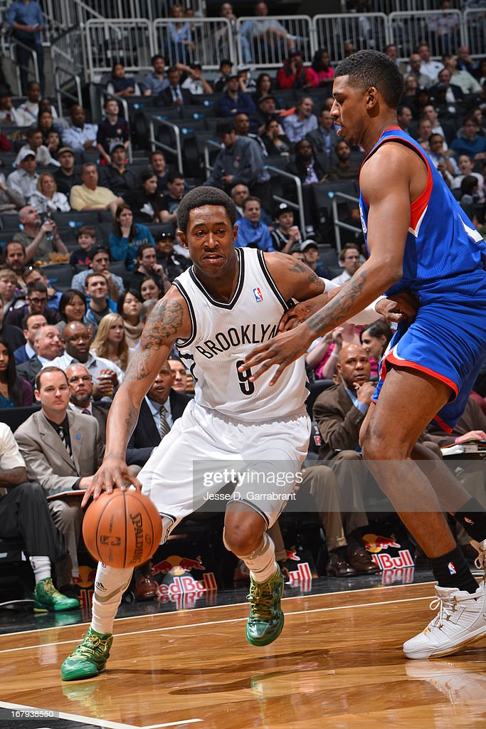 <a gi-track='captionPersonalityLinkClicked' href=/galleries/search?phrase=MarShon+Brooks&family=editorial&specificpeople=4884862 ng-click='$event.stopPropagation()'>MarShon Brooks</a> #9 of the Brooklyn Nets drives against Nick Young #1 of the Philadelphia 76ers on April 9, 2013 at the Barclays Center in Brooklyn, New York.