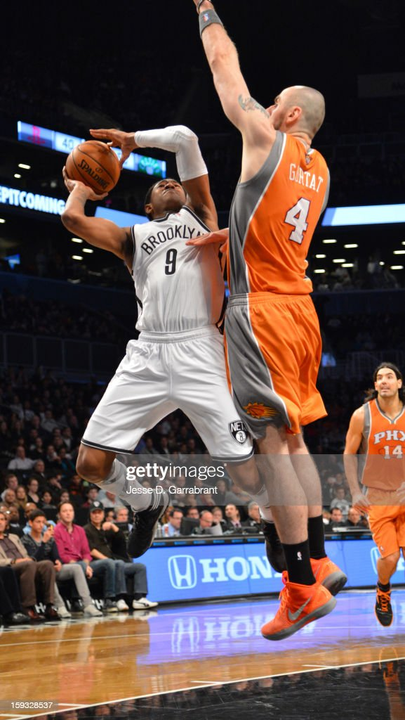 MarShon Brooks #9 of the Brooklyn Nets drives to the basket against Marcin Gortat #4 of the Phoenix Suns during the game at the Barclays Center on January 11, 2013 in Brooklyn, New York.