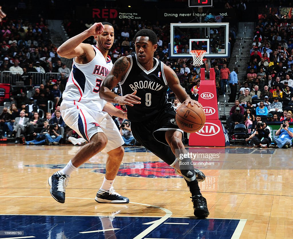 MarShon Brooks #9 of the Brooklyn Nets drives to the basket against Devin Harris #34 of the Atlanta Hawks on January 16, 2013 at Philips Arena in Atlanta, Georgia.