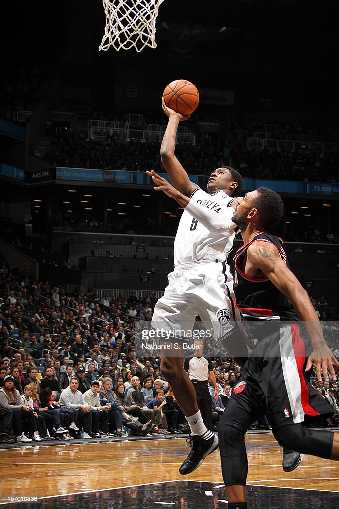 MarShon Brooks #9 of the Brooklyn Nets drives to the basket past Jared Jeffries #1 of the Portland Trail Blazers on November 25, 2012 at the Barclays Center in the Brooklyn Borough of New York City.