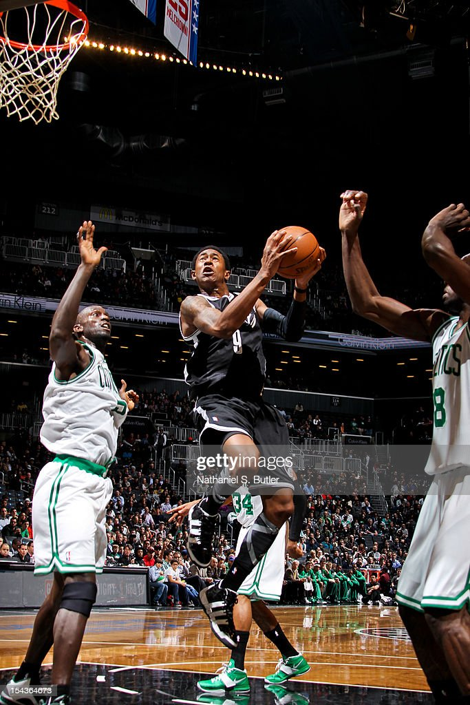 MarShon Brooks #9 of the Brooklyn Nets goes to the basket against Kevin Garnett #5 of the Boston Celtics during a pre-season game on October 18, 2012 at the Barclays Center in the Brooklyn borough of New York City.