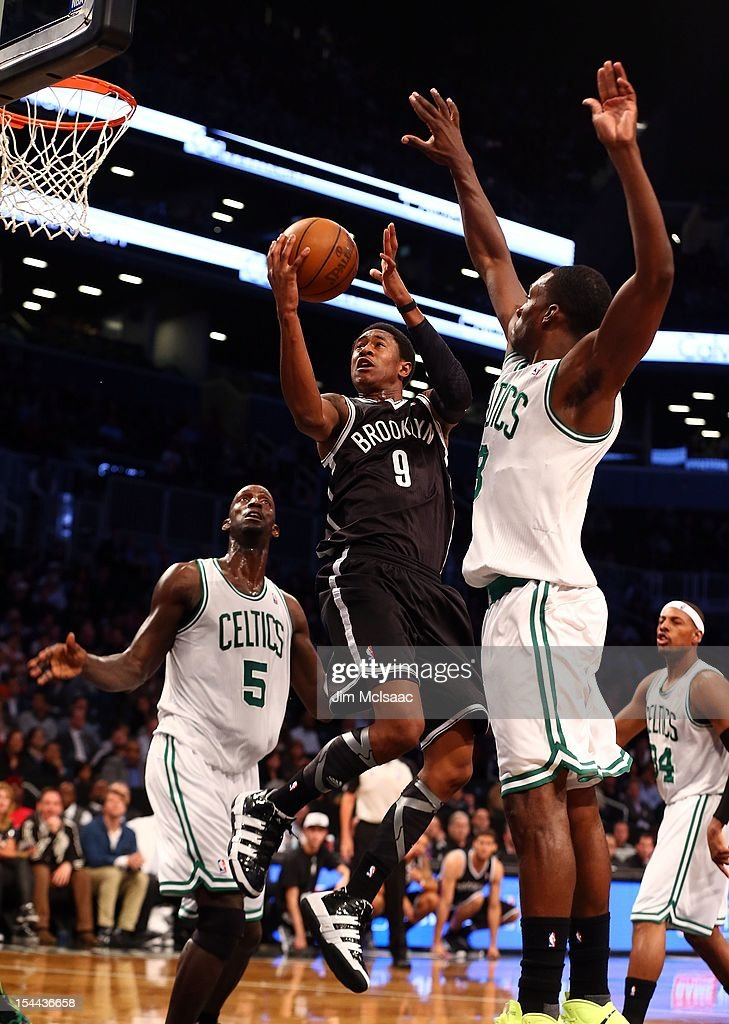 MarShon Brooks #9 of the Brooklyn Nets goes to the hoop against Jeff Green #8 and Kevin Garnett #5 of the Boston Celtics during a preseason game at the Barclays Center on October 18, 2012 in the Brooklyn borough of New York City. The Celtics defeated the Nets 115-85.