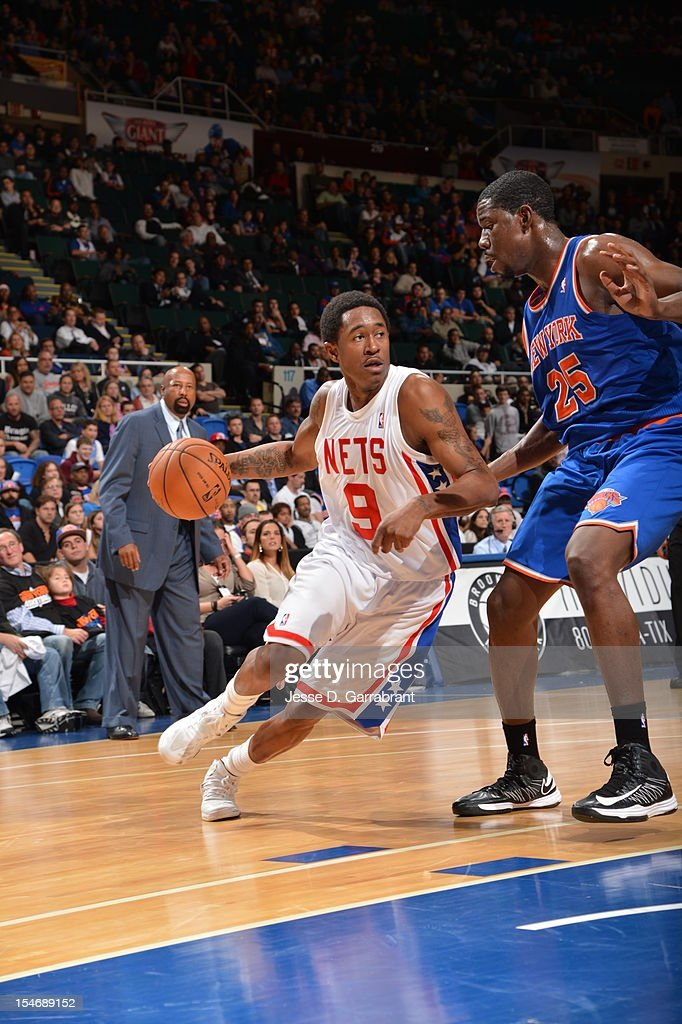 MarShon Brooks #9 of the Brooklyn Nets handles the ball against Henry Sims #25 of the New York Knicks on October 24, 2012 at the Nassau Veterans Memorial Coliseum in Long Island, New York.