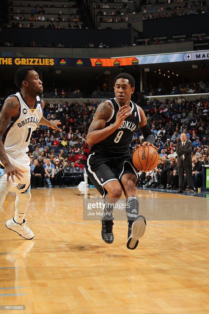 <a gi-track='captionPersonalityLinkClicked' href=/galleries/search?phrase=MarShon+Brooks&family=editorial&specificpeople=4884862 ng-click='$event.stopPropagation()'>MarShon Brooks</a> #9 of the Brooklyn Nets handles the ball against <a gi-track='captionPersonalityLinkClicked' href=/galleries/search?phrase=Tony+Wroten&family=editorial&specificpeople=7651920 ng-click='$event.stopPropagation()'>Tony Wroten</a> #1 of the Memphis Grizzlies on January 25, 2013 at FedExForum in Memphis, Tennessee.