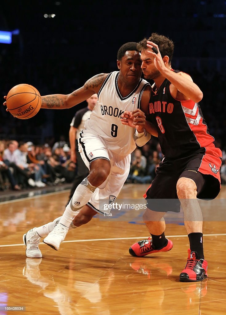<a gi-track='captionPersonalityLinkClicked' href=/galleries/search?phrase=MarShon+Brooks&family=editorial&specificpeople=4884862 ng-click='$event.stopPropagation()'>MarShon Brooks</a> #9 of the Brooklyn Nets heads to the net as <a gi-track='captionPersonalityLinkClicked' href=/galleries/search?phrase=Jose+Calderon&family=editorial&specificpeople=548297 ng-click='$event.stopPropagation()'>Jose Calderon</a> #8 of the Toronto Raptors defends on November 3, 2012 in the Brooklyn borough of New York City. The Brooklyn Nets defeated the Toronto Raptors 107-100.