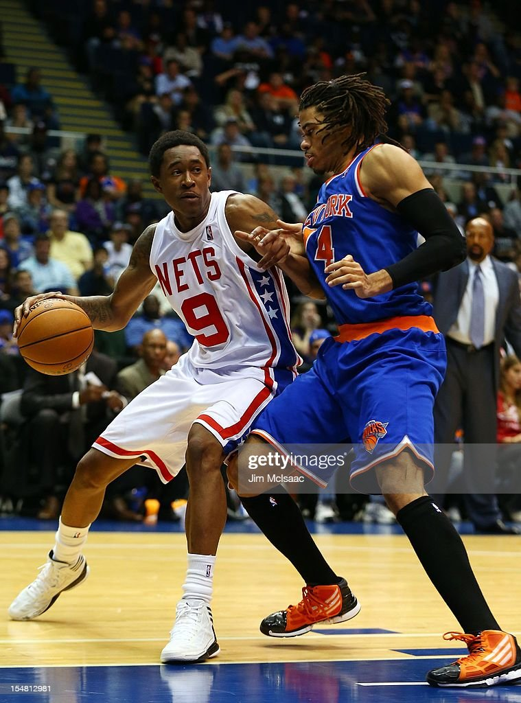 MarShon Brooks #9 of the Brooklyn Nets in action against Chris Copeland #14 of the New York Knicks during a preseason game at Nassau Coliseum on October 24 2012 in Uniondale, New York The Knicks defeated the Nets 97-95.