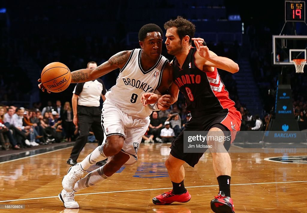MarShon Brooks #9 of the Brooklyn Nets in action against Jose Calderon #8 of the Toronto Raptors at the Barclays Center on November 3, 2012 in the Brooklyn borough of New York City.The Nets defeated the Raptors 107-100 to win the first regular season game to be played at the new Barclays Center.