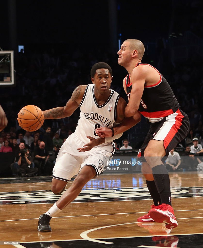 MarShon Brooks #9 of the Brooklyn Nets moves the ball against Sasha Pavlovic #3 of the Portland Trail Blazers at the Barclays Center on November 25, 2012 in the Brooklyn borough of New York City.