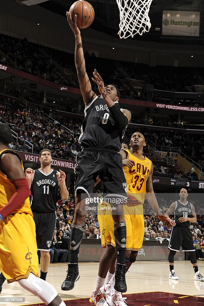 <a gi-track='captionPersonalityLinkClicked' href=/galleries/search?phrase=MarShon+Brooks&family=editorial&specificpeople=4884862 ng-click='$event.stopPropagation()'>MarShon Brooks</a> #9 of the Brooklyn Nets shoots a layup against the Cleveland Cavaliers at The Quicken Loans Arena on April 3, 2013 in Cleveland, Ohio.