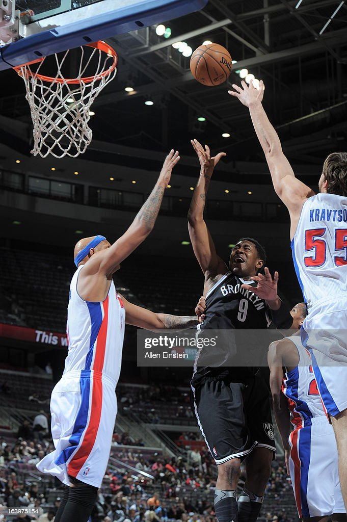 MarShon Brooks of the Brooklyn Nets shoots against Charlie Villanueva and Viacheslav Kravtsov of the Detroit Pistons on March 18 2013 at The Palace...