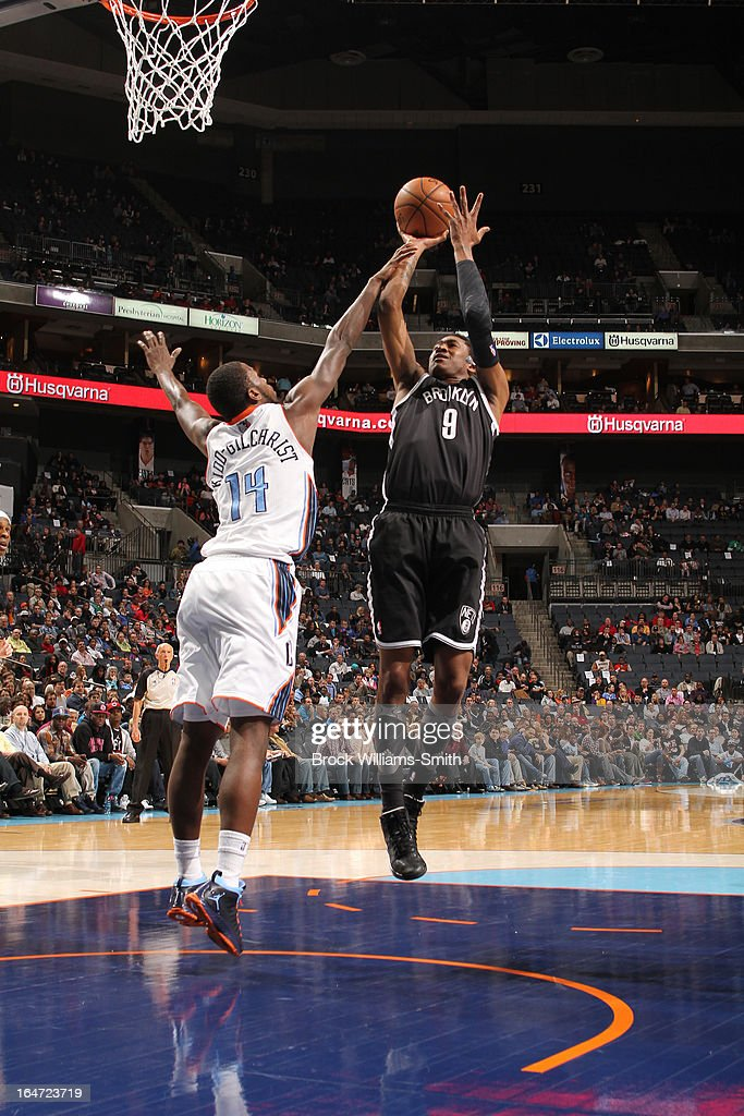 MarShon Brooks #9 of the Brooklyn Nets shoots against Michael Kidd-Gilchrist #14 of the Charlotte Bobcats at the Time Warner Cable Arena on March 6, 2013 in Charlotte, North Carolina.