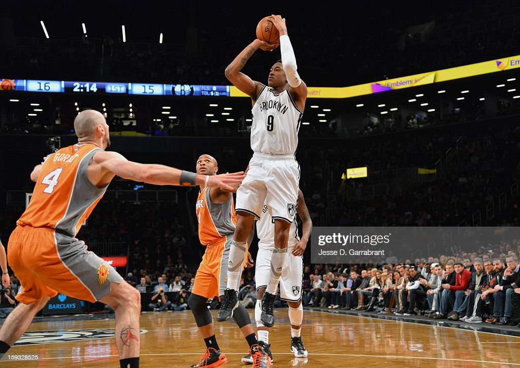 MarShon Brooks #9 of the Brooklyn Nets takes a shot against Marcin Gortat #4 of the Phoenix Suns during the game at the Barclays Center on January 11, 2013 in Brooklyn, New York.