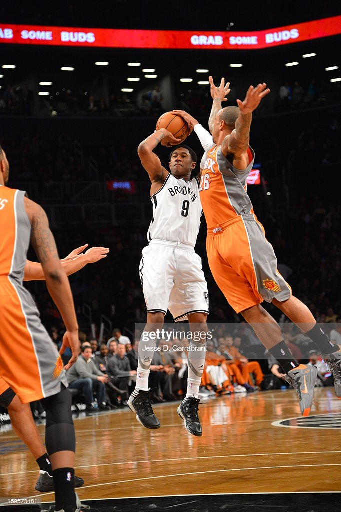 <a gi-track='captionPersonalityLinkClicked' href=/galleries/search?phrase=MarShon+Brooks&family=editorial&specificpeople=4884862 ng-click='$event.stopPropagation()'>MarShon Brooks</a> #9 of the Brooklyn Nets takes a shot against the Phoenix Suns at the Barclays Center on January 11, 2013 in Brooklyn, New York.