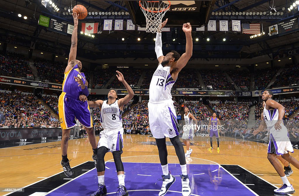<a gi-track='captionPersonalityLinkClicked' href=/galleries/search?phrase=MarShon+Brooks&family=editorial&specificpeople=4884862 ng-click='$event.stopPropagation()'>MarShon Brooks</a> #2 of the Los Angeles Lakers shoots against <a gi-track='captionPersonalityLinkClicked' href=/galleries/search?phrase=Rudy+Gay&family=editorial&specificpeople=236066 ng-click='$event.stopPropagation()'>Rudy Gay</a> #8 and Derrick Williams #13 of the Sacramento Kings on April 2, 2014 at Sleep Train Arena in Sacramento, California.