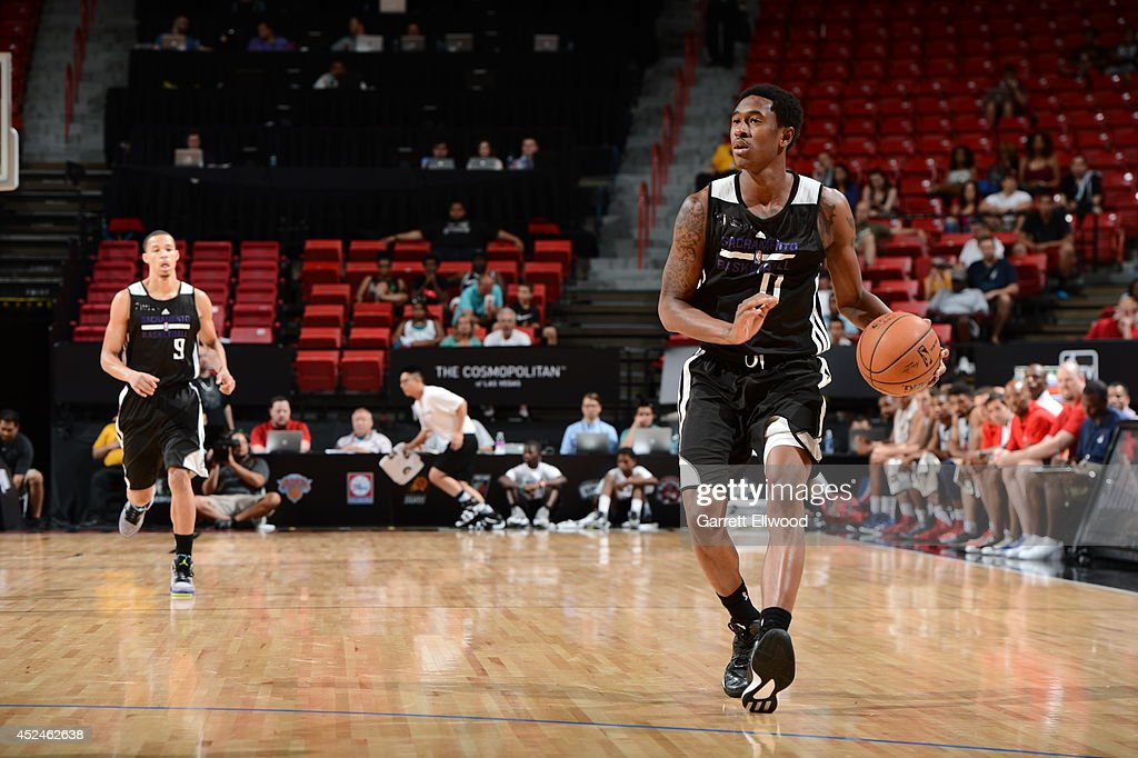 <a gi-track='captionPersonalityLinkClicked' href=/galleries/search?phrase=MarShon+Brooks&family=editorial&specificpeople=4884862 ng-click='$event.stopPropagation()'>MarShon Brooks</a> #0 of the Sacramento Kings handles the ball against the Washington Wizards at the Samsung NBA Summer League 2014 on July 20, 2014 at the Thomas and Mack Center in Las Vegas, Nevada.