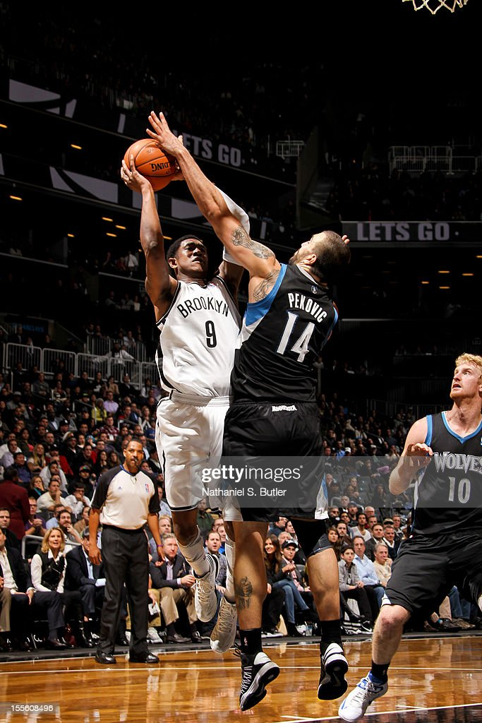 MarShon Brooks #9 shoots against Nikola Pekovic #14 of the Minnesota Timberwolves on November 5, 2012 at the Barclays Center in Brooklyn, New York.