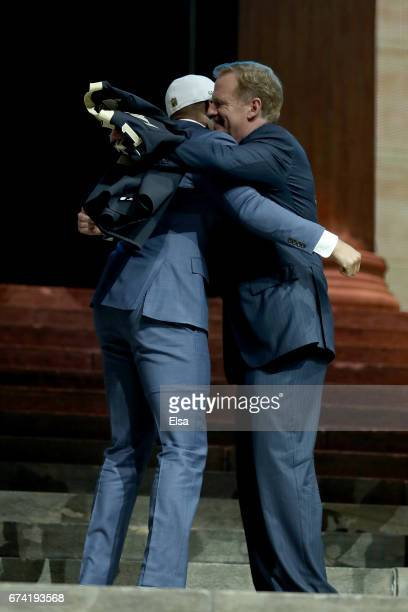 Marshon Lattimore of Ohio State hugs Commissioner of the National Football League Roger Goodell after being picked overall by the New Orleans Saints...
