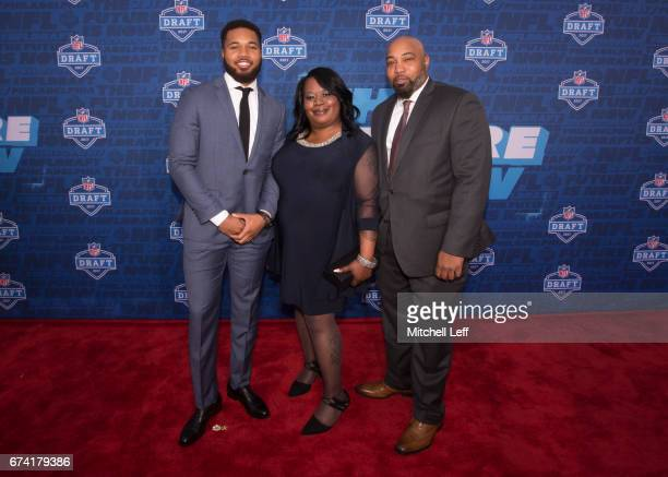 Marshon Lattimore of Ohio State poses for a picture with his mother Felicia Killebrew and father Marland Lattimore Sr on the red carpet prior to the...