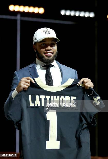 Marshon Lattimore of Ohio State reacts after being picked overall by the New Orleans Saints during the first round of the 2017 NFL Draft at the...