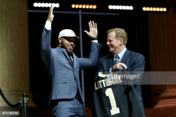 Marshon Lattimore of Ohio State reacts with Commissioner of the National Football League Roger Goodell after being picked overall by the New Orleans...