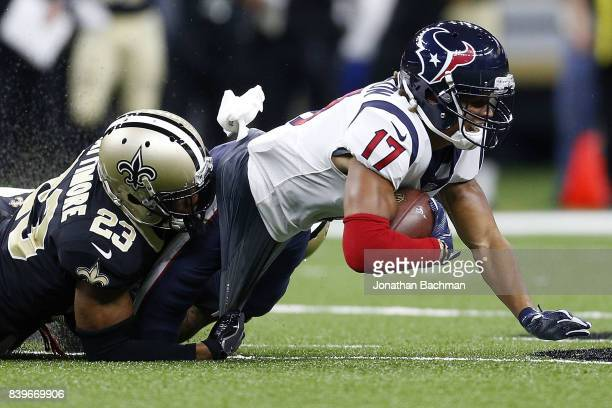 Marshon Lattimore of the New Orleans Saints tackles Dres Anderson of the Houston Texans during the first half of a preseason game at the MercedesBenz...