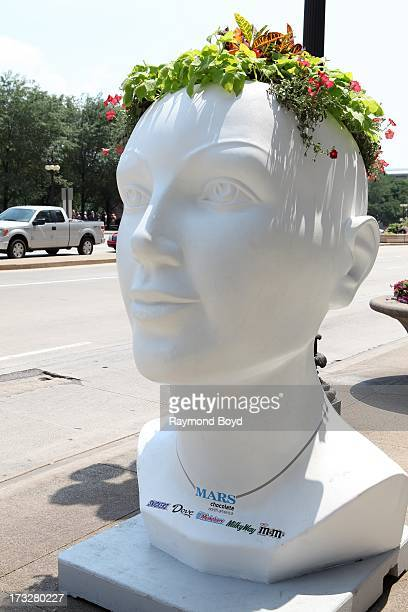 MARSsponsored lifesized head shaped planter sculpture built from recycled aluminum steel and concrete materials are displayed along the Chicago...