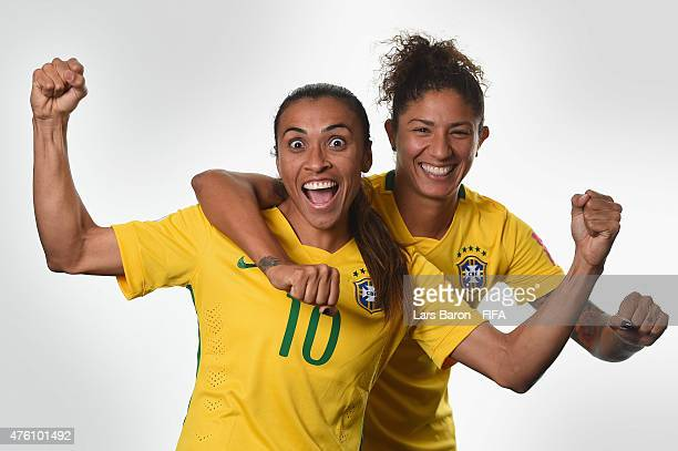 Marta and Cristiane of Brazil poses during the FIFA Women's World Cup 2015 portrait session at Sheraton Le Centre on June 6 2015 in Montreal Canada