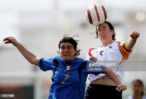 Marta Carissimi of Italy goes up for a header with Birgit Prinz of Germany during the Algarve Cup 7th place match between Germany and Italy at Stadio...