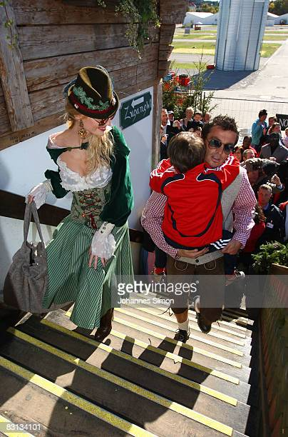 Marta Cecchetto girlfriend of Luca Toni of Bayern Muenchen and Massimo Oddo with his child arrive at the Kaefer beer tent at the Oktoberfest beer...