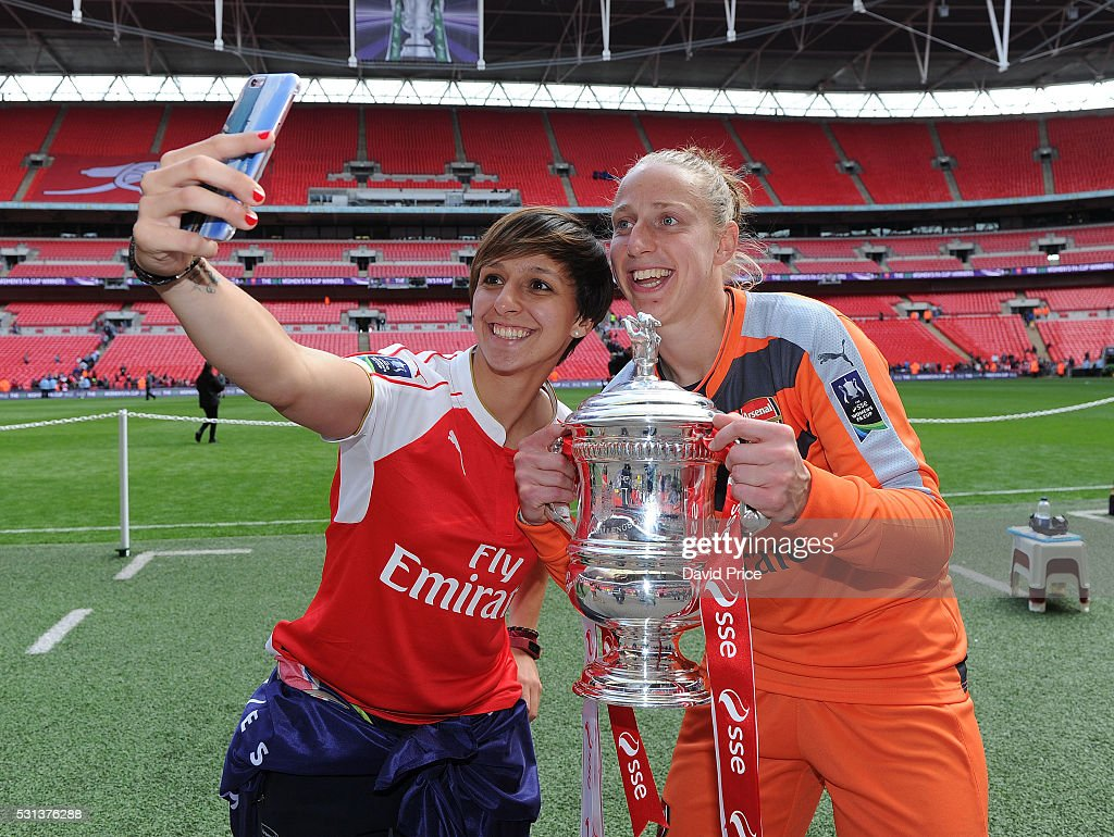 Marta Corredera and Sari van Veenendaal of Arsenal Ladies with the FA Cup Trophy after the match between Arsenal Ladies and Chelsea Ladies at Wembley Stadium on May 14, 2016 in London, England.