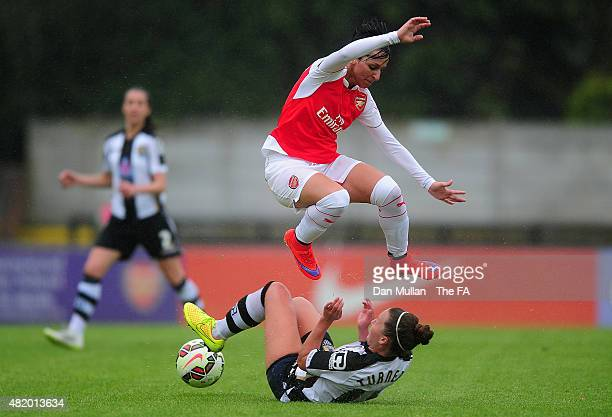 Marta Corredera of Arsenal leaps over the tackle of Amy Turner of Notts County during the WSL match between Arsenal Ladies and Notts County Ladies at...