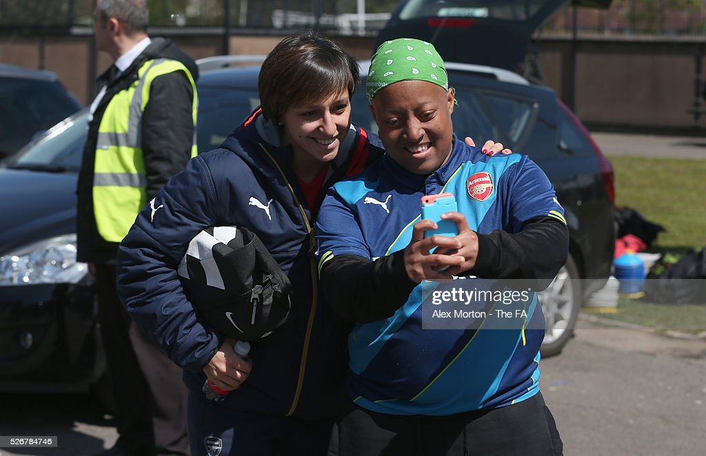 <a gi-track='captionPersonalityLinkClicked' href=/galleries/search?phrase=Marta+Corredera&family=editorial&specificpeople=8671709 ng-click='$event.stopPropagation()'>Marta Corredera</a> of Arsenal takes a selfie with a fan prior the WSL match between Arsenal Ladies and Birmingham City Ladies at Meadow Park on May 1, 2016 in Borehamwood, England.