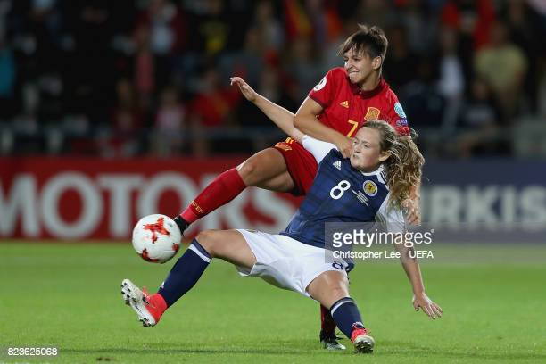 Marta Corredera of Spain and Erin Cuthbert of Scotland battle for possession during the Group D match between Scotland and Spain during the UEFA...