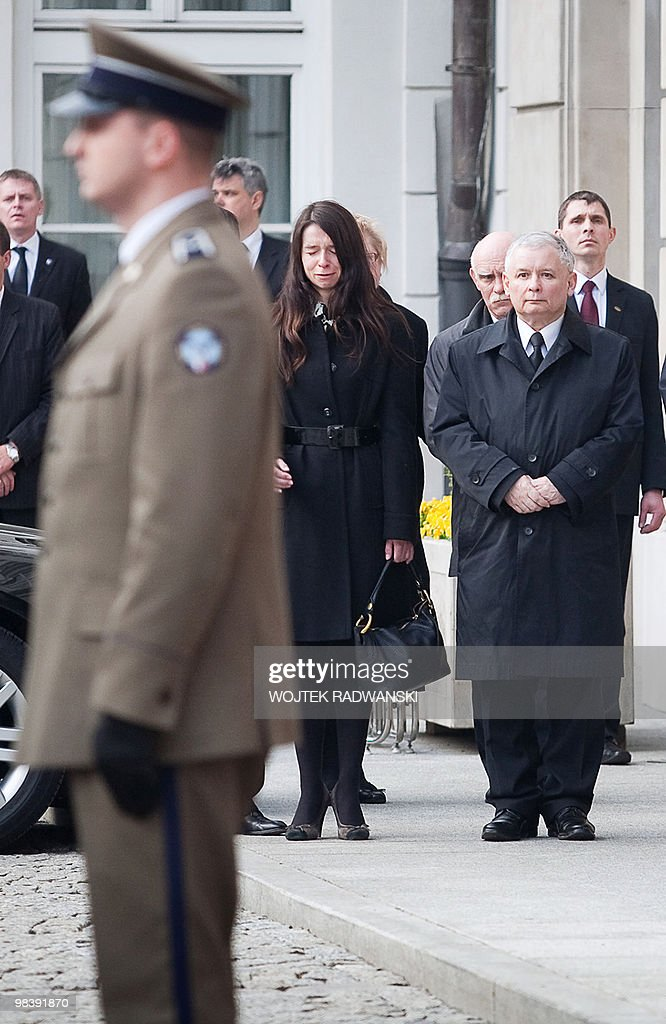 Marta (C), daughter of Lech and Maria Kaczynski cries next to her uncle Jaroslaw Kaczynski (R), twin brother of the late Polish President, as the coffin (unseen) is carried inside the Presidential Palace in Warsaw on April 11, 2010. The body of Poland's late president arrived back home on April 11 as his stunned nation mourned the loss of much of its elite in a jet crash in Russia that investigators said was not due to technical faults. Draped in a red and white Polish flag, the coffin bearing <a gi-track='captionPersonalityLinkClicked' href=/galleries/search?phrase=Lech+Kaczynski&family=editorial&specificpeople=544054 ng-click='$event.stopPropagation()'>Lech Kaczynski</a> was carried onto a red carpet at Warsaw Airport, where it was met by his identical twin brother Jaroslaw, a former premier, and a presidential guard of honour.