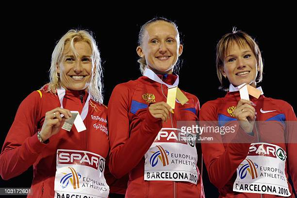 Marta Dominguez of Spain receives the silver medal Yuliya Zarudneva of Russia receives the gold medal and Lyubov Kharlamova of Russia receives the...