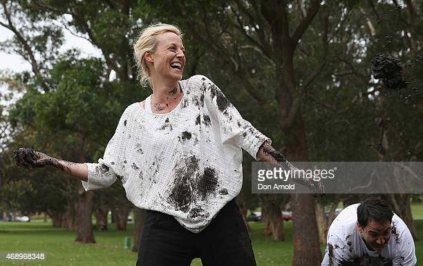 Marta Dusseldorp and Michael Wipfli participate in a mud fight to raise awareness about the 'Mud Pie Project' to help raise funds to complete the Ian...
