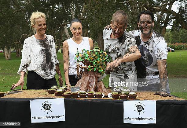 Marta Dusseldorp Terri Biviano Greig Pickhaver and Michael Wipfli pose after participating in a mud fight to raise awareness about the 'Mud Pie...