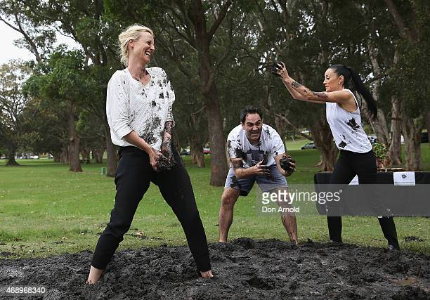 Marta DusseldorpMichael Wipfli and Terri Biviano participate in a mud fight to raise awareness about the 'Mud Pie Project' to help raise funds to...