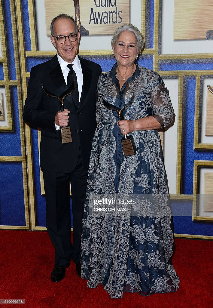 Marta Kauffman and David Crane pose in the press room at the Writers Guild Awards, in Century City, California, February 13, 2016. / AFP / CHRIS DELMAS