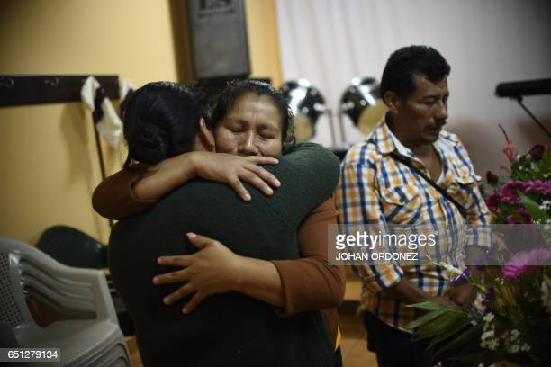Marta Lidia Garcia is comforted during the wake of her 17yearold daughter Siona Hernandez who died in a fire at a staterun shelter at Ciudad Peronia...