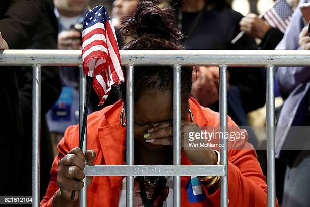 Marta Lunez prays on her knees as election results come in at Democratic presidential nominee former Secretary of State Hillary Clinton's election...