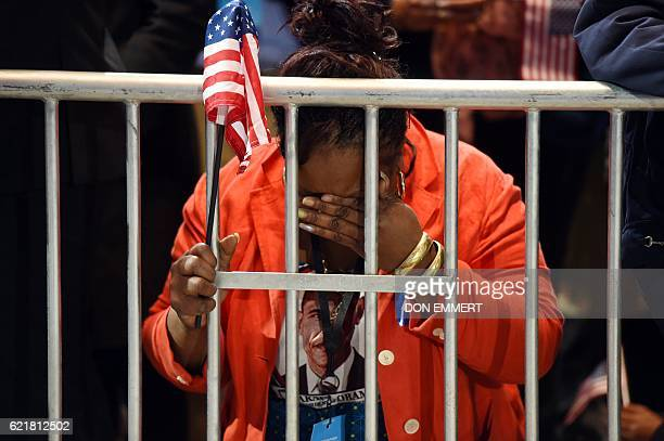 Marta Lunez supporter of US Democratic presidential nominee Hillary Clinton reacts to elections results during election night at the Jacob K Javits...