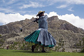 Marta Mamani an aymara indigenous woman hits a drive during her work break at La Paz Golf Club on November 26 2008 La Paz Golf Club is considered to...