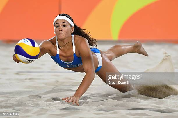 Marta Menegatti of Italy dives for the ball during the Women's Beach Volleyball preliminary round Pool D match against Jamie Lynn Broder and Kristina...