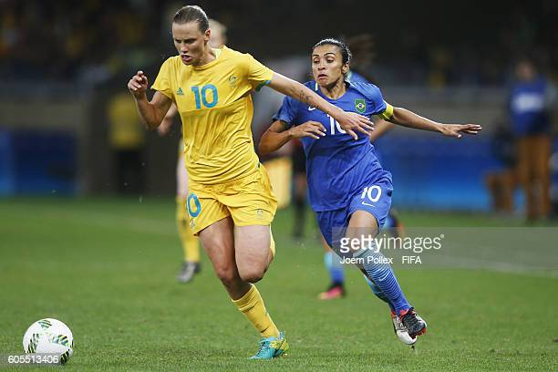 Marta of Brasil and Emily van Egmond of Australia compete for the ball during the Women's Quarter Final match between Brasil and Australia on Day 7...