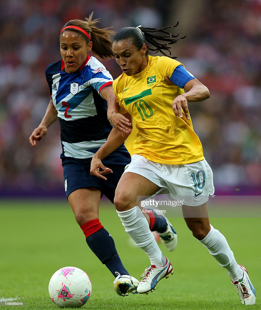 Marta of Brazil battles for the ball with Alex Scott of Great Britain during the Women's Football first round Group E Match between Great Britain and...