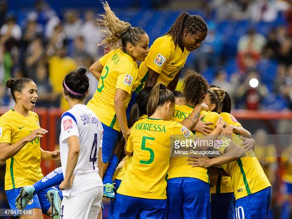 Marta of Brazil celebrates a goal on a penalty kick with teammates in the second half during the 2015 FIFA Women's World Cup Group E match against...