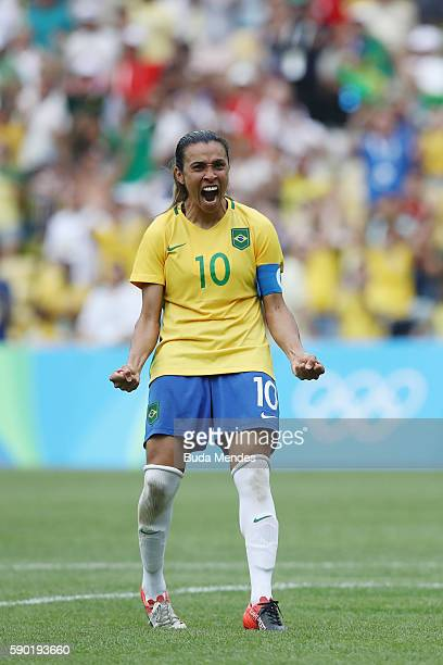 Marta of Brazil celebrates a penalty during the Women's Football Semi Final between Brazil and Sweden on Day 11 of the Rio 2016 Olympic Games at...